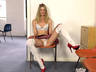 Leggy college girl offers dirty talk as she strips solo
