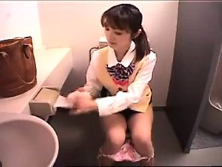 Horny Oriental girl sits on the toilet and fingers herself