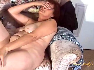 Chubby redheaded granny gets wet playing with her cunt