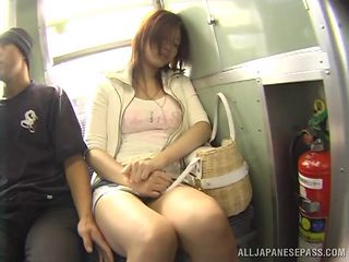 Asian chick with huge tits getting her pussy fingered on a train