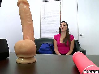 Lovely amateur brunette Melanie Hicks gets a bit scared when she sees giant dildos on the back ro...