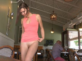 Restaurant upskirt with the cute girl flashing her pussy