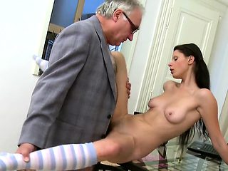 Horny aged teacher is pounding chick's cunt tenaciously