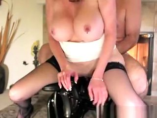 Busty pierced woman and big dildo machine