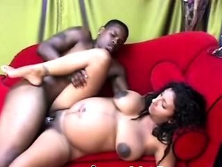 A naughty pregnant big tit ebony chick blows large dick
