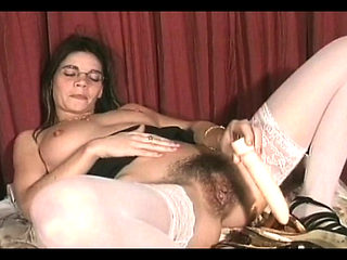 Luscious cutie in nylons Gina copulates her unshaved bawdy cleft with a large fake penis