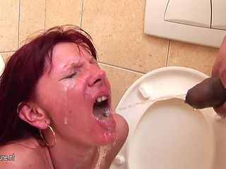 Mom gets deep throat and pissing on a public toilet