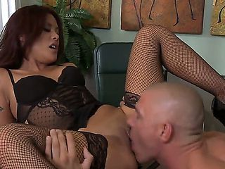 Lusty redhead pornstar whore Kaylani Lei in provocative lingerie and fish net stockings gives hea...