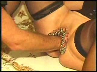 Slut lady with very pierced pussy was fisted very hard