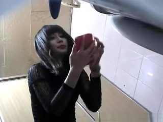 Asian woman takes a pee