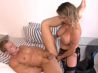Busty blonde Latina fucks a dude with a strapon cock