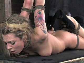 Tattooed blonde tied and dominated by a brutal blowjob