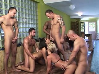 A pack of horny men get into an out-of-control orgy with some chicks