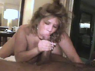 Huge breasted blonde housewife gets drilled by a black bull on the bed