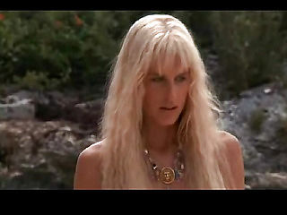 Daryl Hannah nude walking across some grass with her bare rear end showing and her long hair cove...