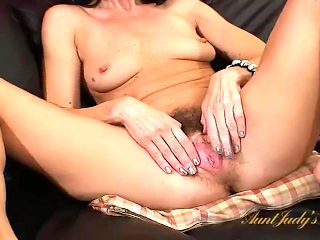 Hot old lady pleasures her perfect hairy cunt