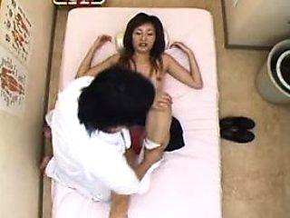 Sexy slim Japanese cutie has a masseur bringing her pussy t