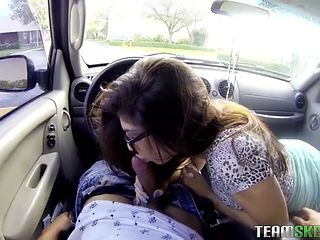 Skirt and glasses girl blows him in a public parking lot