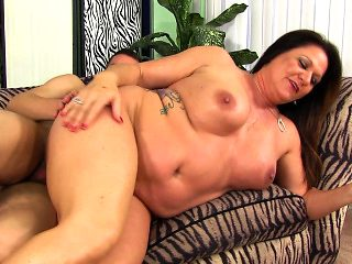 Big breasted mature nympho feeds her lust for young meat and hard sex