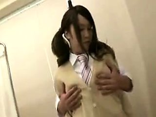 Pretty Oriental teen with pigtails has her doctor caressing