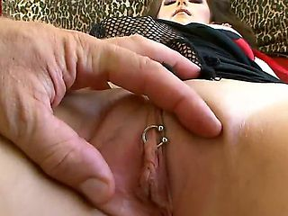 Kinky arousing brunette slut with pierced clit in whorish fishnet gloves teases and then gives lu...