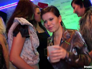 Gorgeous and well dressed party girls dance and drink