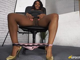 Sexy black babe masturbating in the office