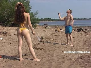 Turned on teen sweetheart gets fucked outdoors on a beach