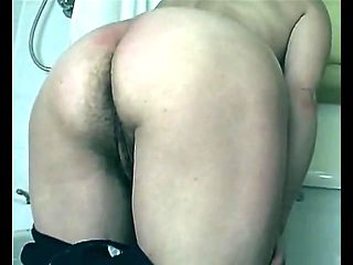 Hairy mature in swimsuit shows pussy from behind