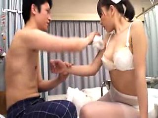 Busty Oriental nurse with hot legs has a patient caressing