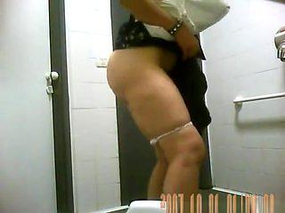 Women caught pissing in public toilet