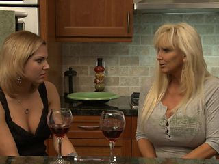 Mature big boobed lesbian seduces the hot girl next door