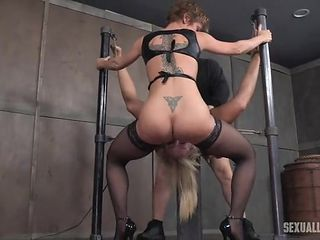 Rope bound blonde fucked from both ends