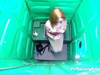 Porta Gloryhole Hot Redhead sucking dick in public porta potty gloryhole