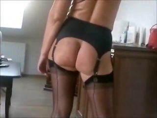 Outside in nylon stockings garter belt and bare ass