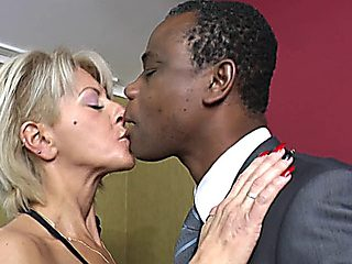 Mature Lady Rides Black Pole