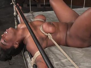 Black whore tied to the bed and fucked in the dungeon
