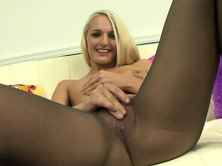 Bodacious blonde girl in pantyhose Maci Lee fucks a dildo on the sofa