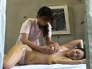 Striking Oriental masseuse uses fingers and toys to deliver