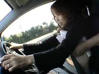 She's driving the car while a couple of horny dudes grope h