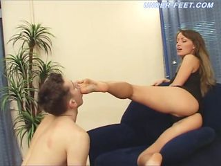 Luscious brunette really likes having her sexy feet licked