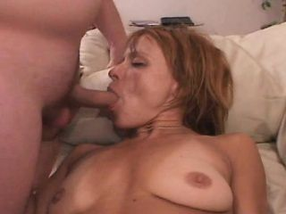 Stacked redhead housewife Cynthia reaches her climax between two dicks