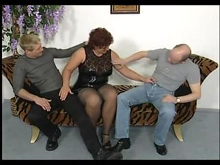 Mature in stockings seduces two guys