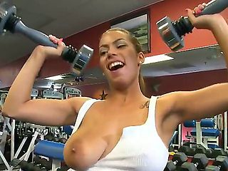 Jasmine has amazing natural boobs and she remains alone with her sexy trainer Jmac in the gym