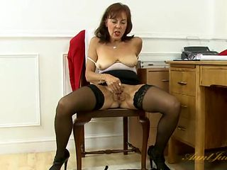 Secretary in black stockings rubs her old cunt