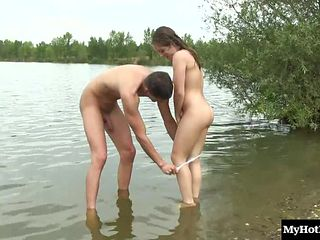Irresistible cutie gets nailed hard on a shore of a lake