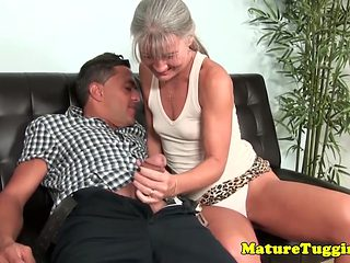 Smalltitted mature jerking on cock