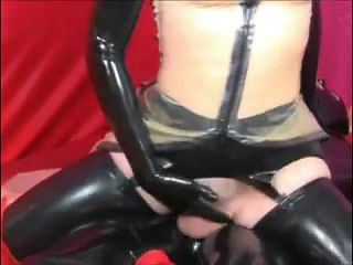 Mistress in latex fucks a male slave