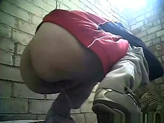 Woman pissing in old place