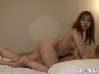 Getting a blowjob from a Japanese babe and playing with her twat